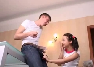 Pigtailed young sister grabs her brother's big cock