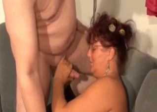 Fat mom jerks and sucks my dick on the sofa